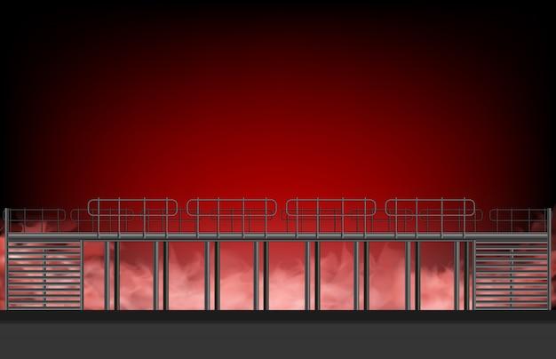 Estructura temporal de estructura de acero con humo rojo y fuego