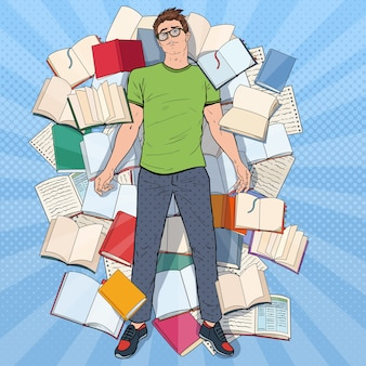 Estudiante agotado del arte pop tirado en el suelo entre libros. hombre joven con exceso de trabajo que se prepara para los exámenes. concepto de educación.