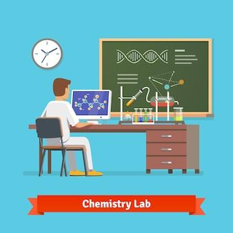 Estudiante universitario haciendo investigación en laboratorio de química