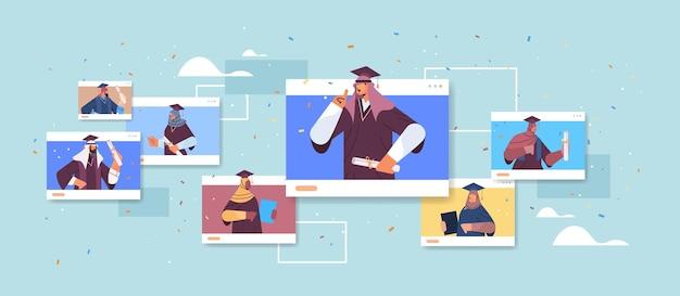 Estudiantes graduados árabes en windows del navegador web felices graduados árabes celebrando el título de diploma académico