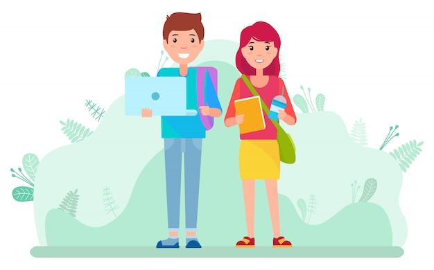 Estudiantes con laptop y libros caminando afuera