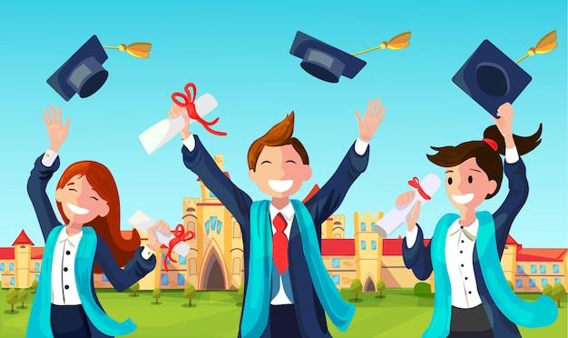 Estudiantes tiran sombreros de graduación en el aire.