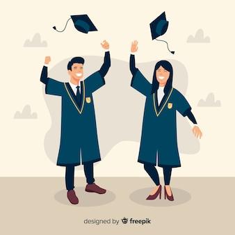 Estudiantes tirando sombreros de graduación al aire