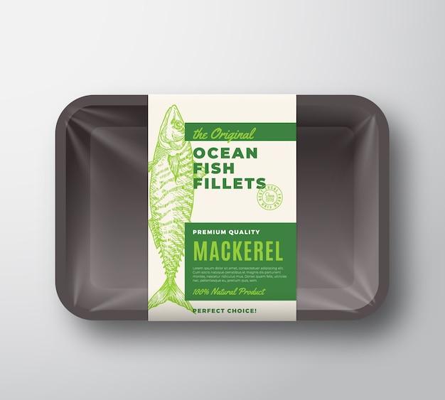 La etiqueta de embalaje abstracta original de filetes de pescado en bandeja de plástico con cubierta de celofán.