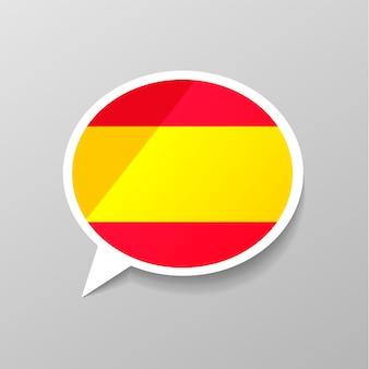 Etiqueta engomada brillante brillante en forma de burbuja de diálogo con la bandera de españa, el concepto de idioma español