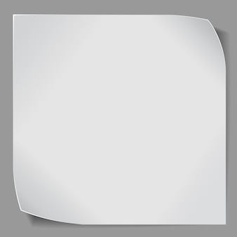Etiqueta engomada de papel sobre fondo gris