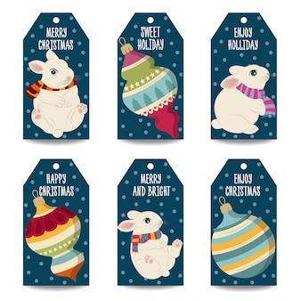 Etiqueta navideña o colección de etiquetas con bolas navideñas y conejos