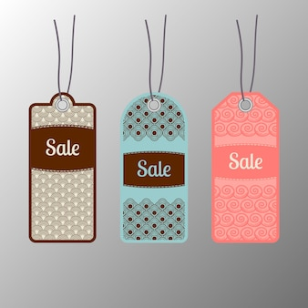 Etiquetas adornadas de la venta fijadas