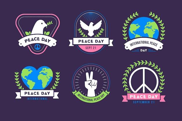 Etiquetas del día internacional de la paz en diseño plano