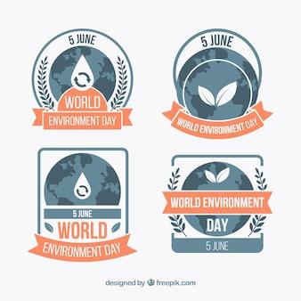 Etiquetas del día mundial del medioambiente con cintas naranjas
