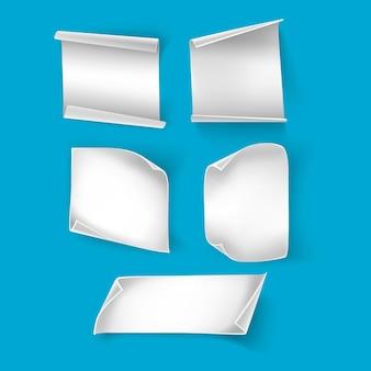 Etiquetas engomadas de papel blanco borde de los papeles de curva y etiqueta en blanco libro o hoja de papel de revista aislado