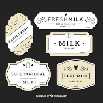 Etiquetas de leche planas con diferentes diseños