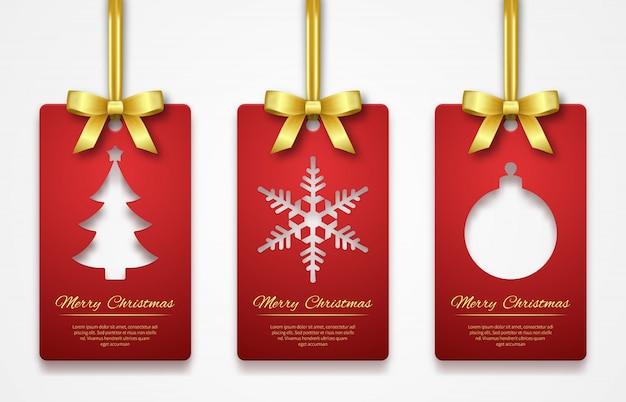 Etiquetas de navidad sobre fondo blanco con cinta dorada