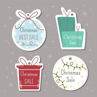 Etiquetas navideñas con letras y elementos dibujados a mano