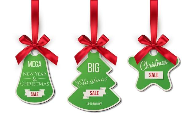 Etiquetas de venta de navidad que ofrecen descuentos.