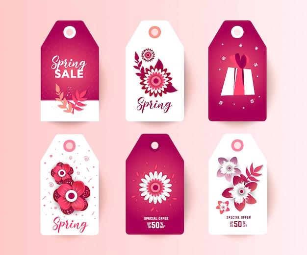 Etiquetas de venta de primavera con la decoración de flores de corte de papel.