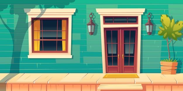 Fachada de la casa con porche de madera y escalones
