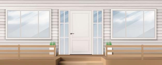 Fachada de la casa con puerta blanca, ventana, pared de revestimiento