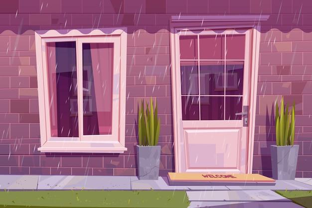 Fachada de la casa con puerta cerrada, ventana y pared de ladrillo bajo la lluvia. exterior del edificio de dibujos animados de vector, frente a casa con alfombra de bienvenida en la puerta, plantas y pasto verde en tiempo lluvioso