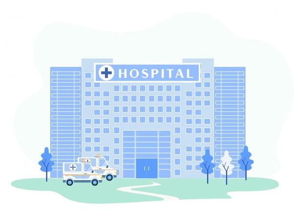 Fachada del edificio del hospital con ambulancias de emergencia.
