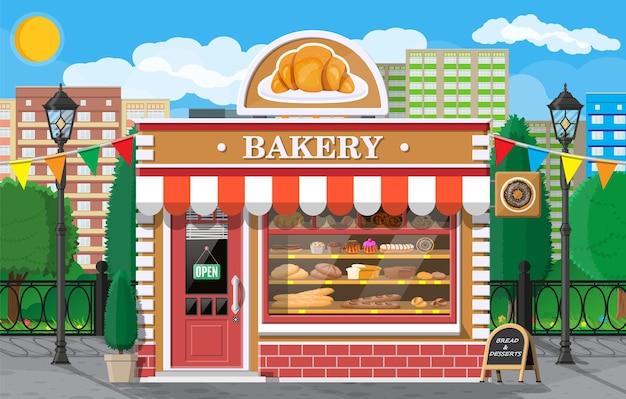 Fachada del edificio de la tienda de panadería con letrero