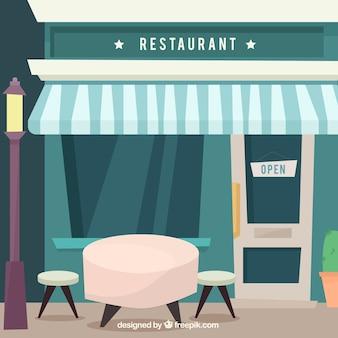 Fachada de restaurante con mesa en diseño plano