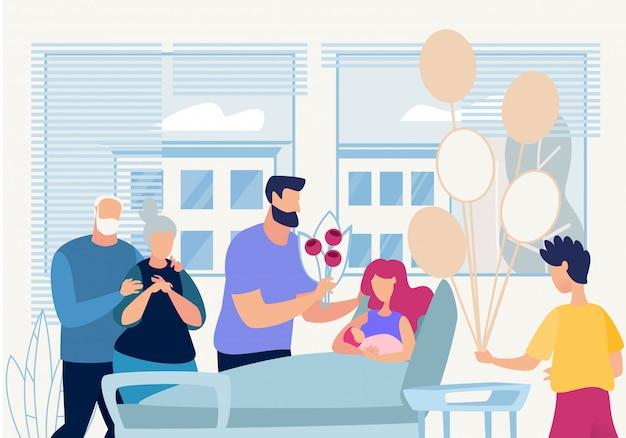La familia banner visita festivamente el nacimiento en el hospital.