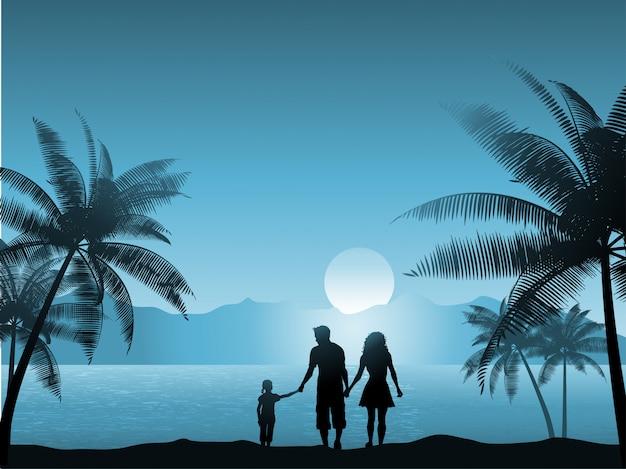 Familia caminando por la playa por la noche