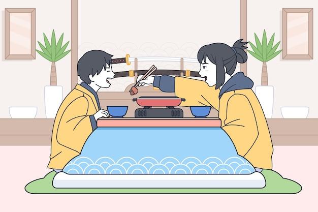 Familia comiendo al estilo manga de una casa occidental