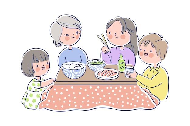 Familia comiendo alrededor de una mesa kotatsu
