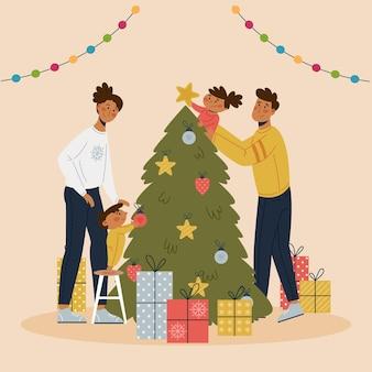Familia decorando la escena del árbol de navidad