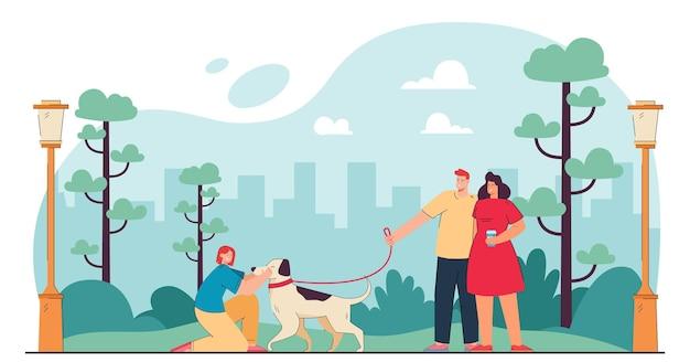 Familia de dibujos animados feliz paseando a un perro en el parque