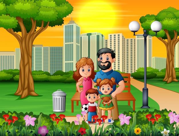 Familia de divertidos dibujos animados en el hermoso parque
