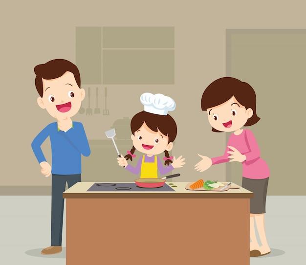Familia e hija cocinando