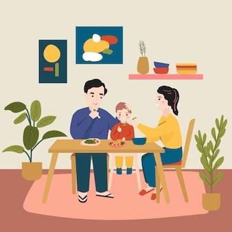 Familia feliz en casa comiendo juntos.