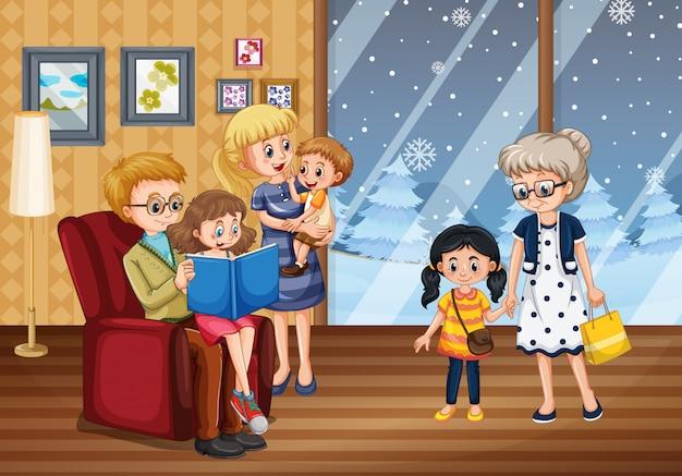 Familia feliz en la casa en invierno