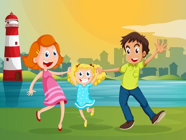 Una familia feliz cerca del río a través del faro