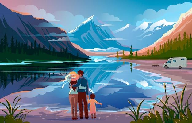 Familia feliz de pie cerca del lago mirando lejos
