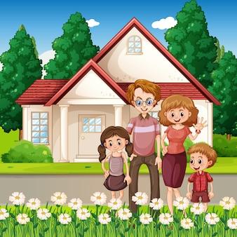 Familia feliz de pie frente a la casa