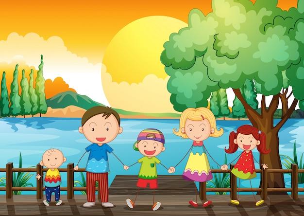 Una familia feliz en el puente de madera.