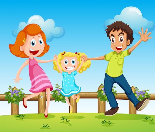 Una familia feliz sobre las colinas con una cerca.