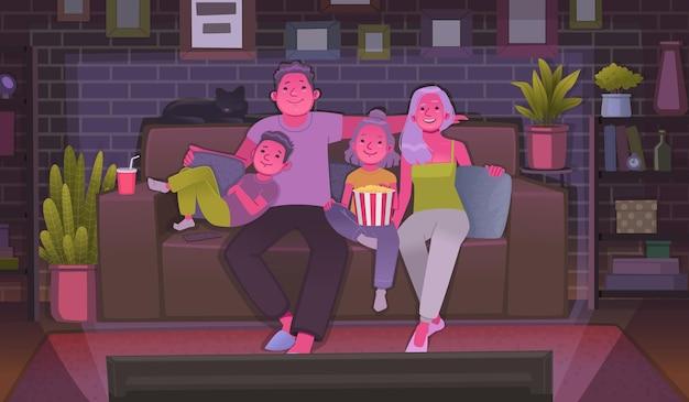 Familia feliz viendo la televisión viendo una película