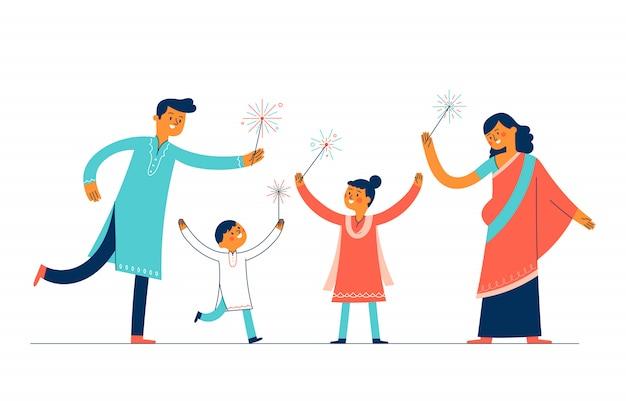 Una familia de madre y padre y dos hijos celebraron el día de diwali encendiendo fuegos artificiales