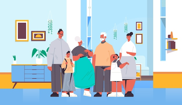 Familia de múltiples generaciones felices abuelos, padres e hijos parados juntos salón horizontal interior