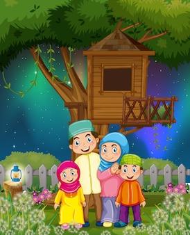 Familia musulmana en el jardín por la noche.