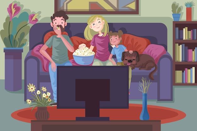 Familia relajándose en casa mientras ve una película