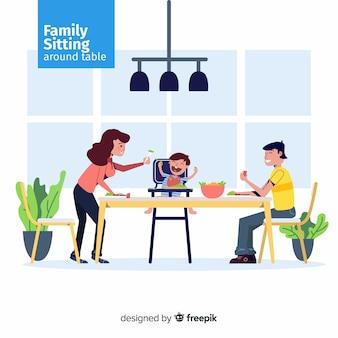 Familia sentada alrededor de la mesa