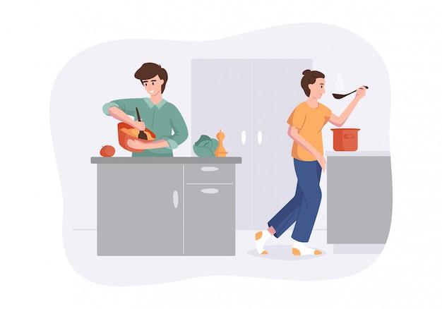 Familia sonriente junto que cocina en la tabla de cocina. la esposa cocinó sopa y la prueba con una cuchara. el hombre golpea la mezcla para cocinar. concepto de preparar comidas caseras para la cena