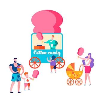 Familias felices en la cafetería de verano comprando algodón de azúcar