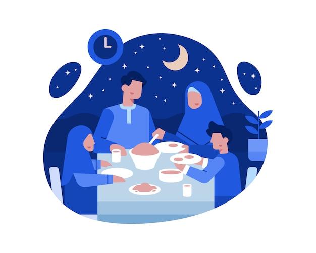 Las familias musulmanas cenan juntas en la mesa del comedor